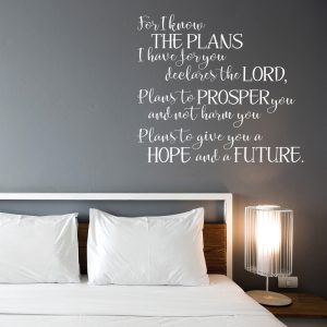 White Jeremiah 29:11 decal with LORD on dark bedroom wall above bed