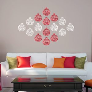 Intricate red and white pomegranate wall art on living room wall