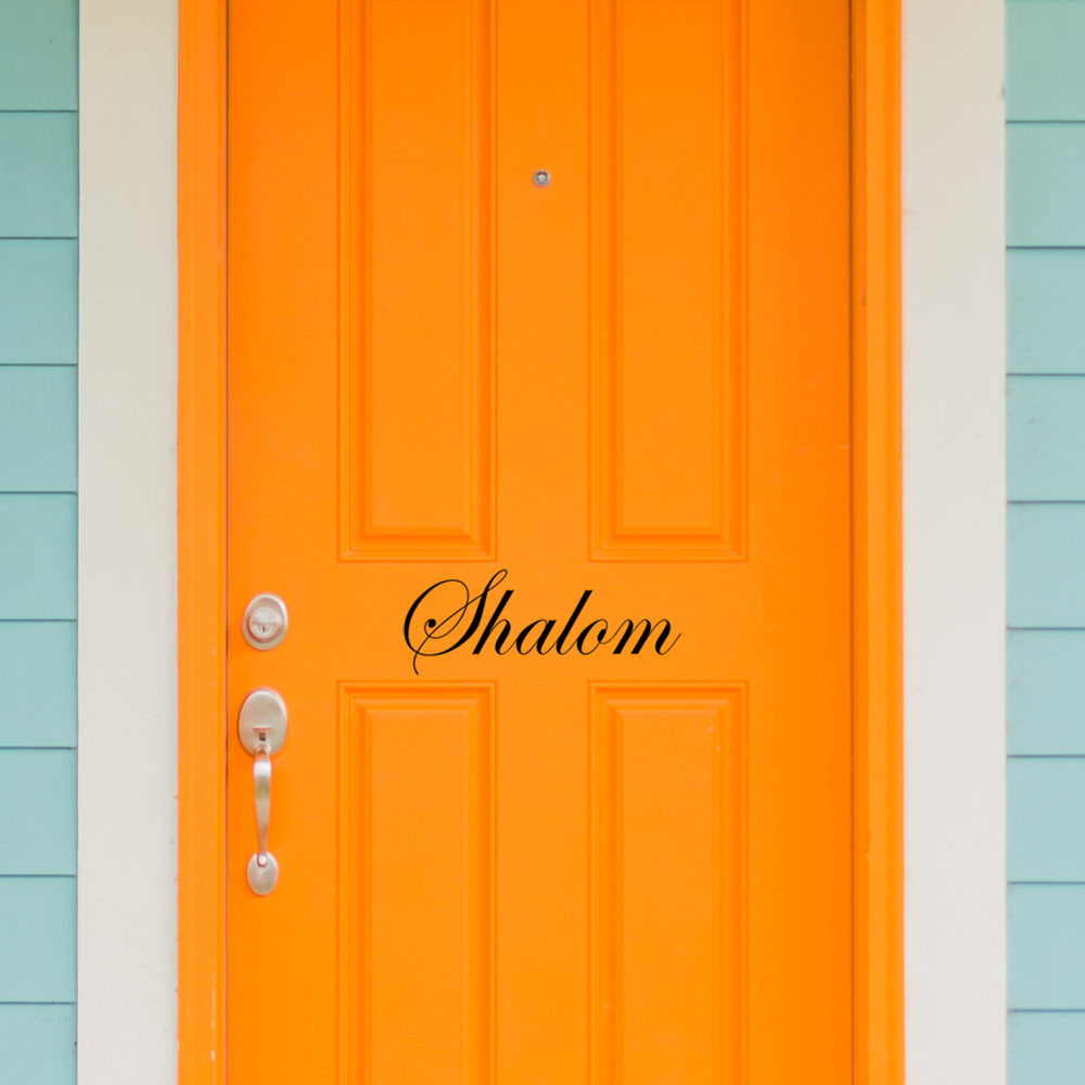Bright colored front door of remodeled urban home, tangerine ora